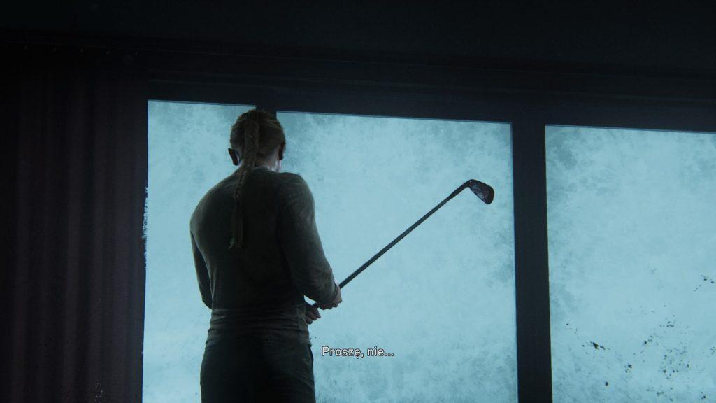 człowiek z kijem golfowmy
